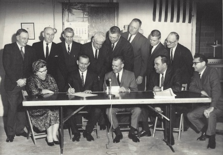 Signing Loan for Original Water Plant